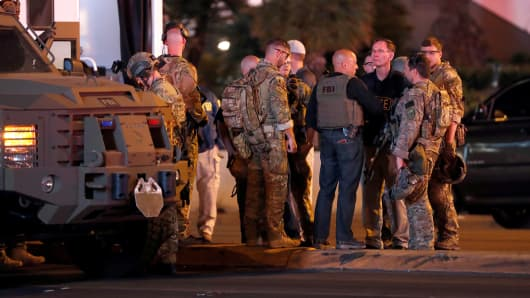 FBI agents confer in front of the Tropicana hotel-casino on October 2, 2017, after a mass shooting during a music festival on the Las Vegas Strip in Las Vegas, Nevada.