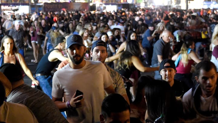 People flee the Route 91 Harvest country music festival grounds after a active shooter was reported.
