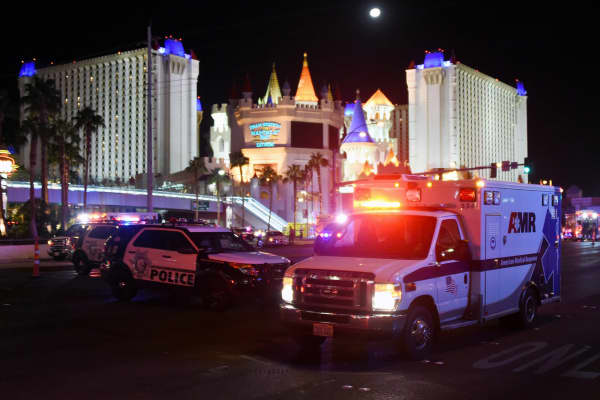 An ambulance leaves the intersection of Las Vegas Boulevard and Tropicana Ave. after a mass shooting at a country music festival nearby on October 2, 2017 in Las Vegas, Nevada.