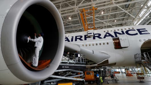 An employee works on an Airbus A380 plane inside the Air France KLM maintenance hangar at the Charles de Gaulle International Airport in Roissy, near Paris, France, May 31, 2016.