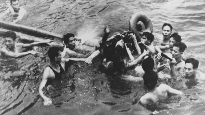 After his plane was shot down, McCain is pulled out of a Hanoi lake by North Vietnamese soldiers and civilians in this October 1967 file photo.