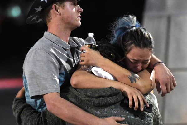 People hug and cry outside the Thomas & Mack Center after a mass shooting at the Route 91 Harvest country music festival on October 2, 2017 in Las Vegas, Nevada.