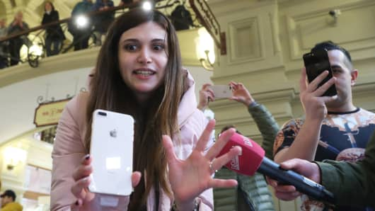 A customer at a re:Store shop in the GUM department store as Apple's latest smartphones iPhone 8 and iPhone 8 Plus officially go on sale in Russia.