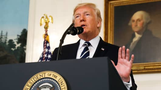 President Donald Trump makes a statement on the mass shooting in Las Vegas in front of a portrait of President George Washington in the Diplomatic Room at the White House in Washington, October 2, 2017.