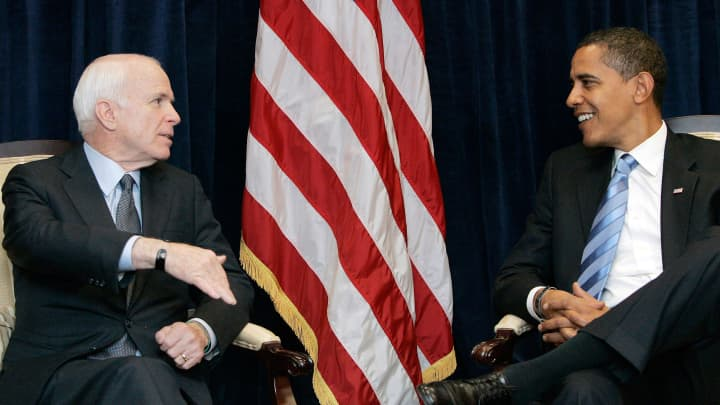 Former Republican presidential candidate Sen. John McCain (R-AZ) (L) meets with President-elect Barack Obama at Obama's transition office November 17, 2008 in Chicago, Illinois. Obama is meeting with McCain for the first time since beating McCain in the presidential election.