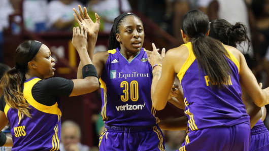 Los Angeles Sparks forward Nneka Ogwumike (30) high fives teammates in Game 1 in the WNBA basketball final Sept. 24, 2017, in Minneapolis.