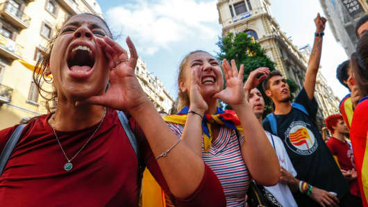 People shout slogans against Spanish National Police during a gathering outside a National Police station, in Barcelona, Spain October 2, 2017.