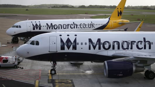 Grounded Monarch airplanes sit on the tarmac at Luton airport, south England on October 2, 2017.