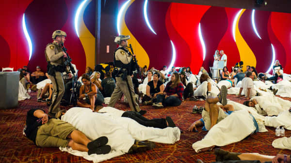 Las Vegas police sweep through a convention center area during a lockdown Monday, Oct. 2, 2017, at the Tropicana Las Vegas following an active shooter situation on the Las Vegas Strip.
