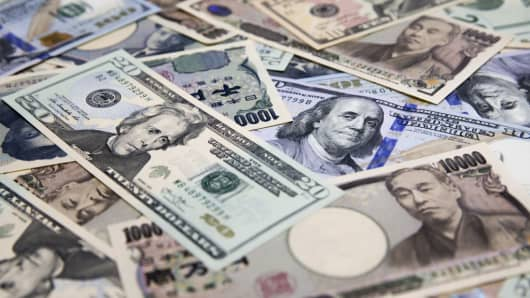 Japanese yen and U.S. dollar banknotes are arranged for a photograph in Tokyo, Japan, on Tuesday, Sept. 5, 2017.