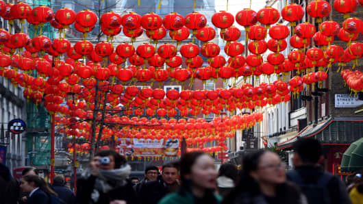 Lanterns strung across Gerrard Street in Chinatown, London, as preparations are made ahead of the Chinese New Year celebrations in January 2017.