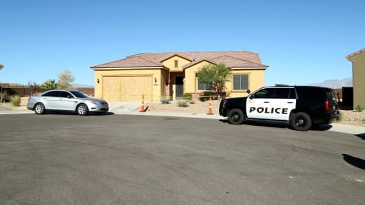 Police cars parked in front of the house in the Sun City Mesquite community where suspected Las Vegas gunman Stephen Paddock lived, October 2, 2017 in Mesquite, Nevada.