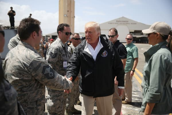 President Donald Trump greets U.S Air Force airmen as he arrives at the Muniz Air National Guard Base as he makes a visit after Hurricane Maria hit the island on October 3, 2017 in Carolina, Puerto Rico.