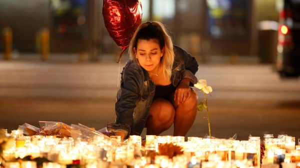 A woman lights candles at a vigil on the Las Vegas strip following a mass shooting at the Route 91 Harvest Country Music Festival in Las Vegas, Nevada, U.S., October 2, 2017.