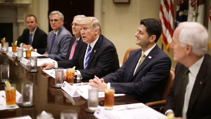 President Donald Trump (C) hosts Office of Managment and Budget Director Mick Mulvaney (L) and Republican Congressional leaders (2nd L-R) Rep. Kevin McCarthy (R-CA); Senate Majority Leader Mitch McConnell (R-KY), Speaker of the House Paul Ryan (R-WI), Sen. John Cornyn (R-TX) and others during a working lunch in the Roosevelt Room at the White House March 1, 2017 in Washington, DC.