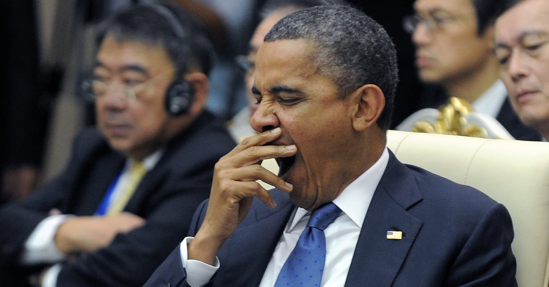 US President Barack Obama yawns as he attends an East Asian Summit Plenary Session at the Peace Palace in Phnom Penh on November 20, 2012.