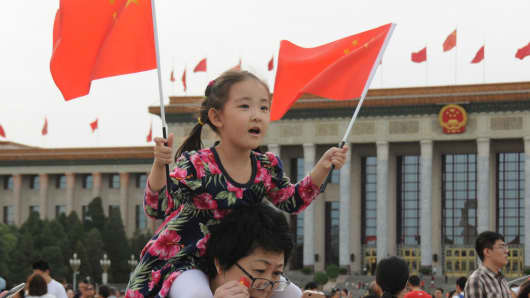 People visit the Tian'anmen Square on National Day on October 1, 2017 in Beijing, China. China is celebrating the 68th anniversary of the founding of the People's Republic of China.