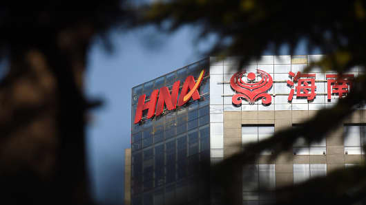 The HNA logo is seen on a building in Beijing.