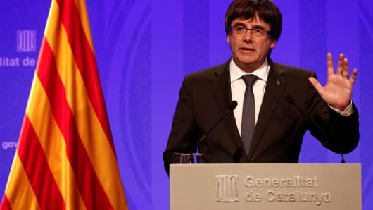 The President of Catalonia Carles Puigdemont (C) holds a press conference after a meeting with the members of the Catalan government at the Catalonian parliament building, also known as Palau de la Generalitat in Barcelona, Spain on October 02, 2017 after the controversial Catalonia's illegitimate independence referendum.