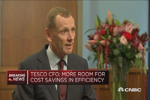 Tesco CFO says on track to complete Booker deal
