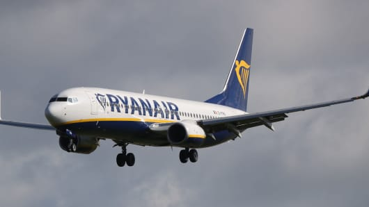 A Ryanair jet lands at Dublin Airport, as the crisis over pilot shortages and warnings that crews are rejecting cash bonuses to commit to the airline will be addressed.