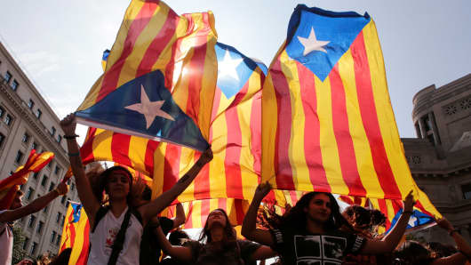 People hold Catalan separatist flags during a demonstration two days after the banned independence referendum in Barcelona, Spain, on October 3, 2017.