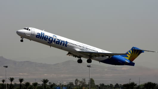 An Allegiant Airlines jet flies out of Las Vegas Airport.