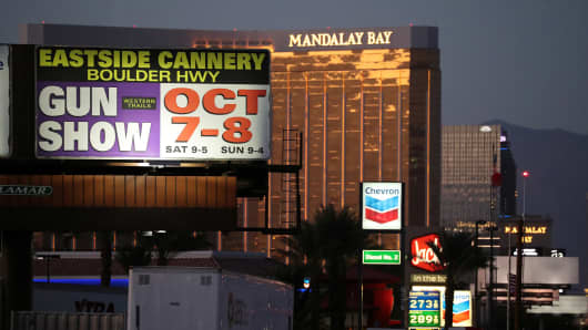 A sign advertising a gun show is seen on the Las Vegas Strip in front of the Mandalay Bay Resort and Casino near the Route 91 music festival mass shooting in Las Vegas, Nevada, U.S. October 3, 2017.