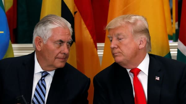 President Donald Trump and Secretary of State Rex Tillerson confer during a working lunch with African leaders during the U.N. General Assembly in New York, Sept. 20, 2017.