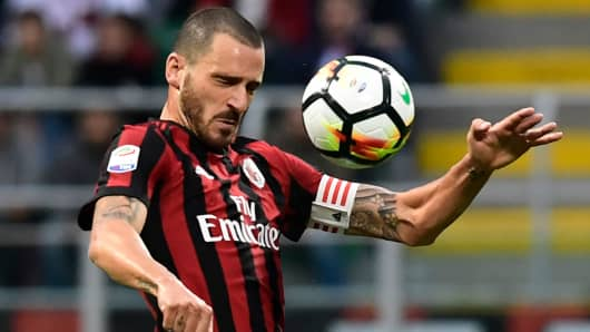 AC Milan's Italian defender Leonardo Bonucci heads the ball during the Italian Serie A football match AC Milan vs AS Roma at the San Siro stadium in Milan on October 1, 2017.
