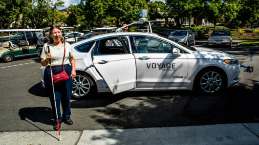 Bev Clifford exits a Voyage self-driving car after a ride in her gated retirement community in San Jose, Calif., Sept. 20, 2017.