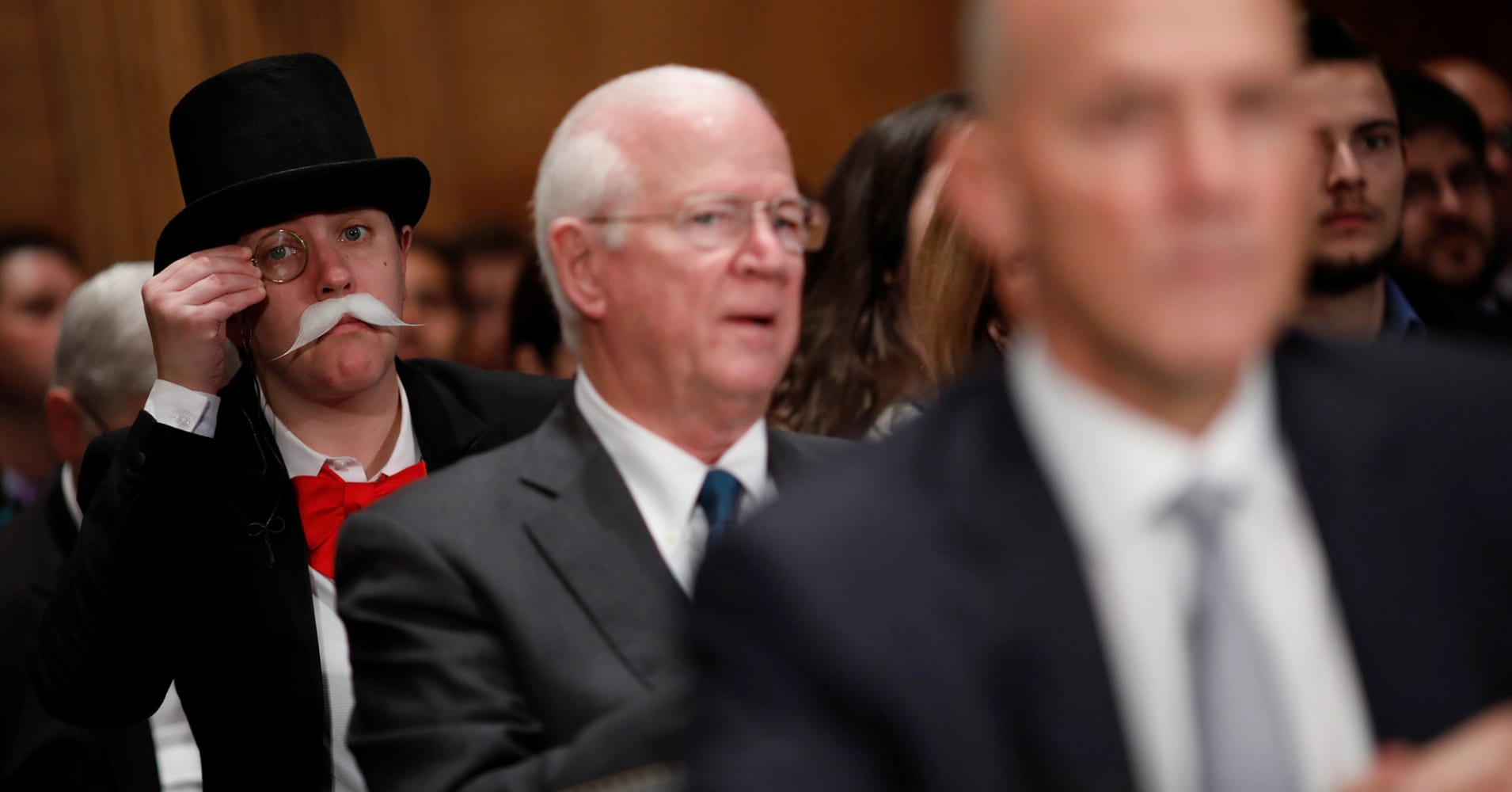 Someone dressed like the Monopoly guy is photobombing the Senate's Equifax hearing