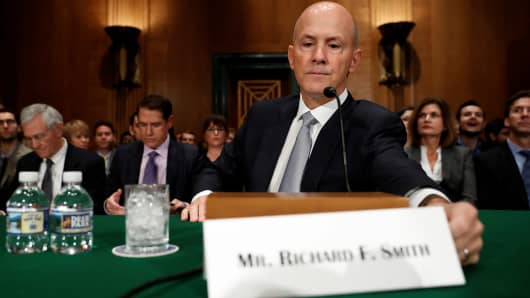 Richard Smith, former chairman and CEO of Equifax, Inc., arrives to testify before the U.S. Senate Banking Committee on Capitol Hill in Washington, U.S., October 4, 2017.
