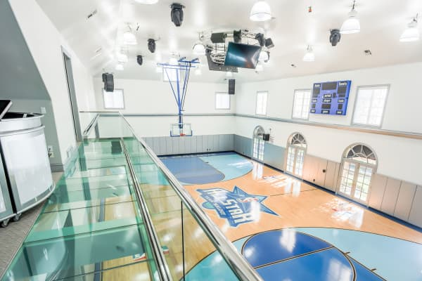 The DJ booth above this indoor basketball court makes this second mega-mansion the ultimate party pad.