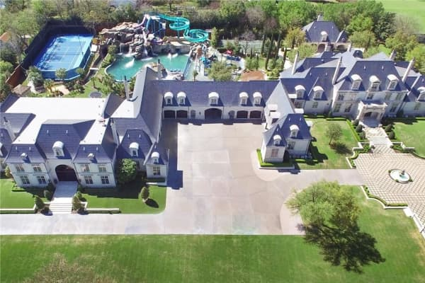 28 million dallas mansion comes with haunted water park for Super mega mansions