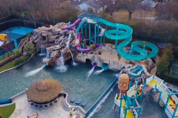 This backyard water park has three water slides, a zip line and a lazy river.