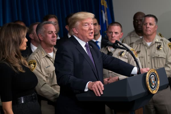 President Donald Trump, joined by first lady Melania Trump and Clark County Sheriff Joe Lombardo (2nd L), delivers remarks at Las Vegas Metropolitan Police Department headquarters, October 4, 2017 in Las Vegas, Nevada.