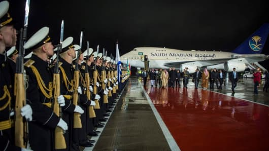 King of Saudi Arabia Salman bin Abdulaziz Al Saud and Deputy Prime Minister of Russia Dmitry Rogozin walk past honor guards during an official welcoming ceremony at Vnukovo International Airport in Moscow, Russia on October 4, 2017.