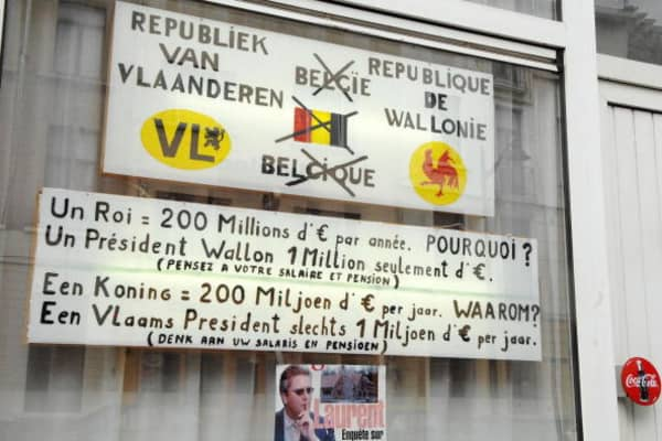 Picture taken 14 May 2007 of two billboards pasted on a shopwindow by a local resident of Ninovse Steenweg, Sint-Jans-Molenbeek / Chaussee de Ninove, Molenbeek-Saint-Jean, expressing his opinion in favour of two republics ie Flanders and Wallonia, instead of the Belgium monarchy, that would cost less money for Belgian citizens (200 millions Euro for monarchy every year while only 1 million Euro for a President). The message warn the population saying ' Think at your pensions, Think at your salary'.