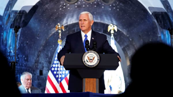 In the shadow of the Space Shuttle Discovery, U.S. Vice President Mike Pence delivers remarks before convening the first meeting of the U.S. National Space Council at the National Air and Space Museum's Udvar-Hazy Center in Chantilly, Virginia, October 5, 2017.