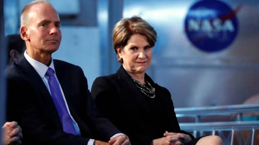 Boeing CEO Dennis Muilenburg and Lockheed Martin CEO Marillyn Hewson participate in the first meeting of the U.S. National Space Council at the National Air and Space Museum's Udvar-Hazy Center in Chantilly, Virginia, October 5, 2017.