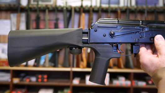 A bump stock device (left) that fits on a semi-automatic rifle to increase the firing speed, making it similar to a fully automatic rifle, is installed on a AK-47 semi-automatic rifle, (right) at a gun store on October 5, 2017 in Salt Lake City, Utah.