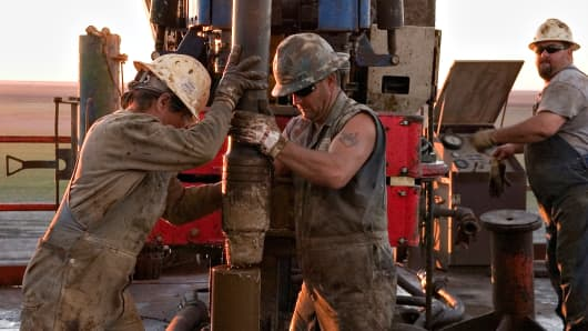 Workers position a section of pipe during drilling operations at a gas well outside Corpus Christi. Patterson-UTI Energy is drilling the well for Decker Operating of Houston.