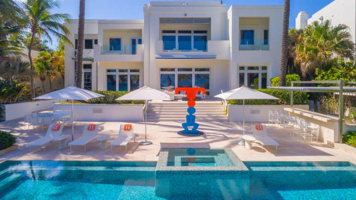 Tommy Hilfiger backyard pool and patio.