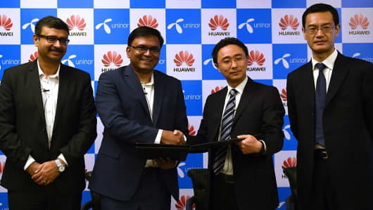 Huawei India Head Jay Chen, fourth from left, at a press conference in New Delhi on August 12, 2015.a