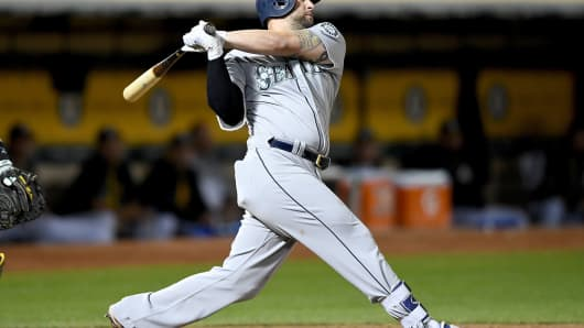 Home-run statistics track the stock market. Pictured, Yonder Alonso of the Seattle Mariners.