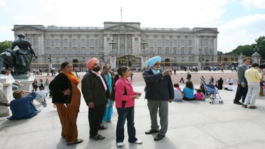 A family of Sikh tourists from Mumbai, India, visit Buckingham Palace in London, U.K., on June 6, 2007.