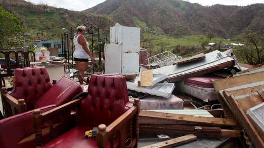 Haydee Mestre looks inside her refrigerator after Hurricane Maria destroyed the town's bridge and the surrounding areas, in San Lorenzo, Morovis, Puerto Rico, October 5, 2017.