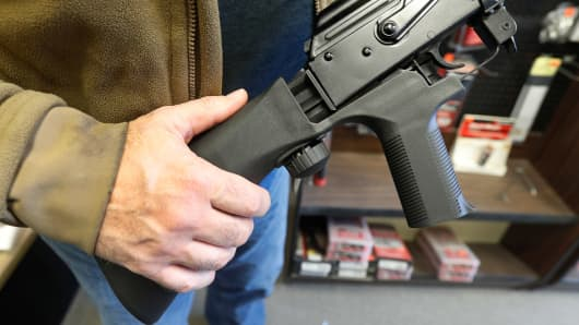 A bump stock device, (left) that fits on a semi-automatic rifle to increase the firing speed, making it similar to a fully automatic rifle, is installed on a AK-47 semi-automatic rifle, (right) at a gun store on October 5, 2017 in Salt Lake City, Utah.