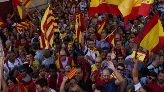 Thousands of demonstrators gather during a Pro-Unity march in response to last Sundays disputed referendum on Catalan independence and to support the unity of Spain on October 8, 2017 in Barcelona, Spain.
